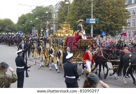 THE HAGUE, HOLLAND - SEPTEMBER 19: Golden Coach with Queen Beatrix on Prinsjesdag in The Hague, Holland on September 19, 2010. Prinsjesdag is the annual presentation of Government Policy to Parliament