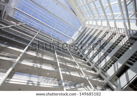 THE HAGUE - JULY 18: Interior of The Hague City Hall. Designed by R. Meier and build in 1995. 4,500 sq. meter atrium flanked by two 10- and 12-storey buildings. July 18, 2013 The Hague, Netherlands - stock photo
