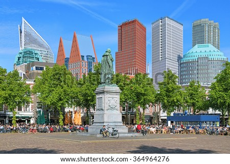 THE HAGUE, NETHERLANDS - MAY 21, 2015: Het Plein Square with the statue of William the Silent on the background of the city's skyscrapers. The square is known for its many restaurants. - stock photo