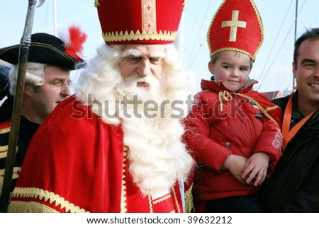 THE HAGUE – NOV 17: Celebrations of greeting Dutch Saint Nicolas called Sinterklaas. He will travel with Black Peters all over the country and hand out sweets on Nov 1, 2007 in The Hague, Netherlands. - stock photo