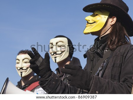 THE HAGUE – OCTOBER 15: Three masked members of Anonymous protesting during the Occupy protest on October 15, 2011 in The Hague, The Netherlands. - stock photo