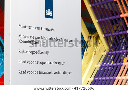 THE HAGUE, THE NETHERLANDS - CIRCA APRIL 2015: Company sign at the entrance to the Dutch Ministry of Finance, Ministry of Interior and Kingdom Relations and other departments of the central government - stock photo