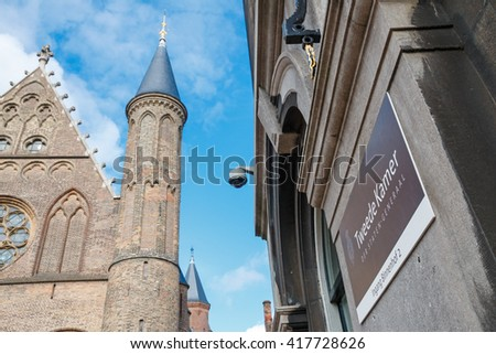 THE HAGUE, THE NETHERLANDS -  CIRCA APRIL 2015: Office sign of the Dutch House of Representatives from the Binnenhof side. In the background the Hall of Knights - stock photo