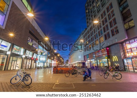 THE HAGUE, THE NETHERLANDS -8th of February 8th, 2015: Night shot of Grote Marktstraat shopping street, close to the Spui.  - stock photo
