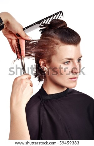 The hairdresser make the haircut - stock photo