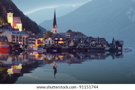 The Hallstatt city in night. Beautiful and mysterious place in Salzkammergut. Austria, Europe. - stock photo