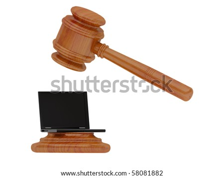 The hammer of the judge strikes on the laptop.