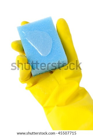 The hand in a glove holds a sponge - stock photo