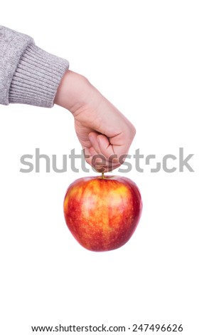 The hand of a little boy holding an apple