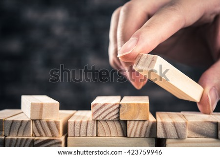 The hand of man has piled up a wooden block