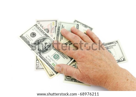 The hand of the man takes away dollars - stock photo