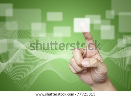 The hand press the button on green background - stock photo