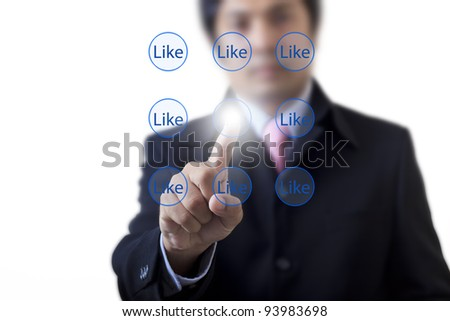The hand pressing Like button - stock photo