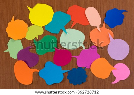 The Handmade Colorful Origami Balloons on the Wooden Background - stock photo