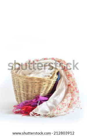 The handmade wooden basket with cloths inside. - stock photo