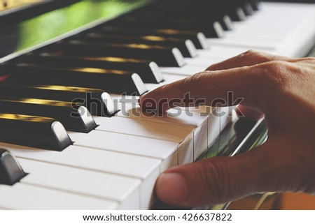 the hands of a man  playing piano. - stock photo