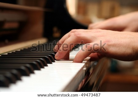 the hands of a piano playing guy in a sensitive mood. - stock photo