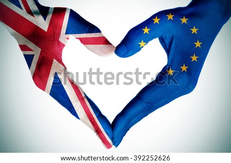 the hands of a young woman patterned with the flag of the United Kingdom and the European Community forming a heart, with a vignette added - stock photo