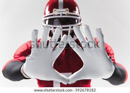 The hands of american football player on white  - stock photo