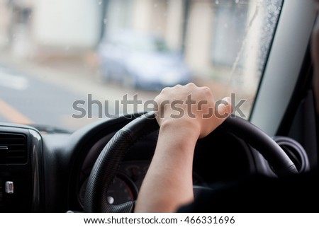 The hands of the driver while driving