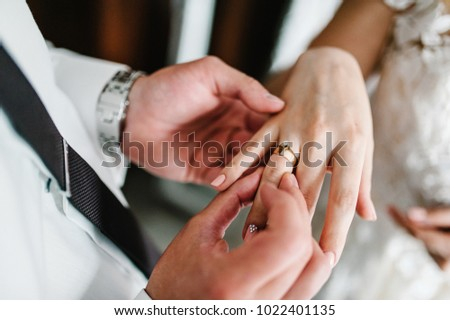 Hands Groom Wears Wedding Engagement Ring Stock Photo 1022401135