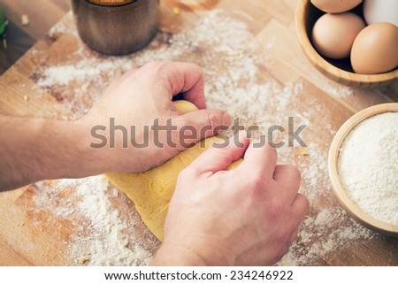 the hands on the dough