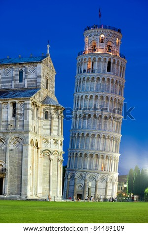 The hanging tower of Pisa with cathedral in front after sunset
