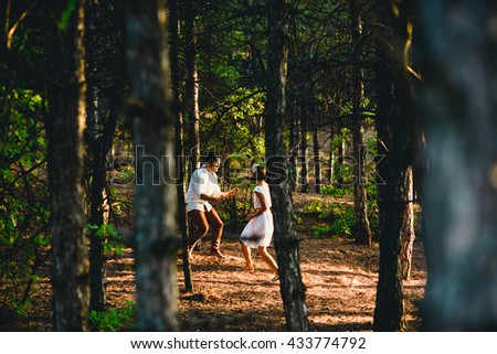 The happinest couple in love running along forest - stock photo