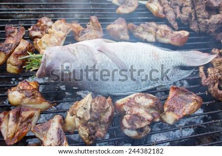 The happy BBQ fish beep pork enjoy holiday - stock photo