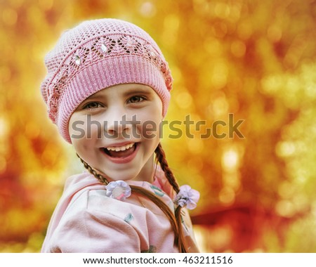 The happy child on a yellow background.