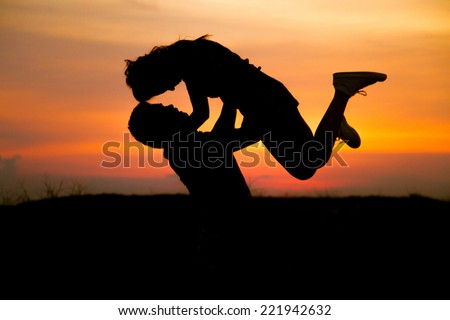 The happy couple on the background of the sunset - stock photo
