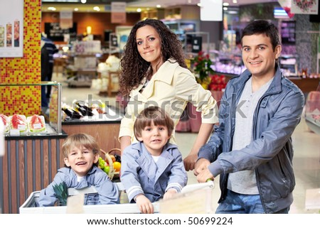 The happy family in shop looks in the chamber - stock photo