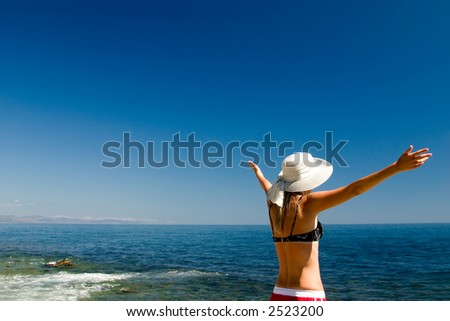 The happy woman on a beach - stock photo