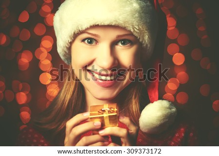 the happy woman with christmas gift - stock photo