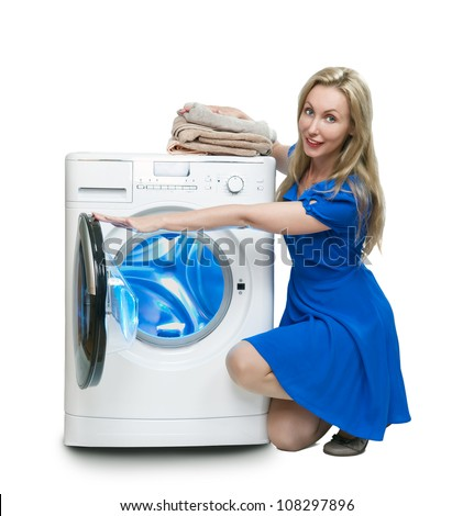 The happy young woman near the new washing machine - stock photo