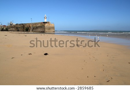 The harbor beach and Smeaton's pier, St. Ives, Cornwall. - stock photo