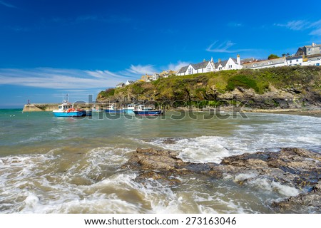 The harbour and beach at Port Isaac Cornwall England UK Europe - stock photo