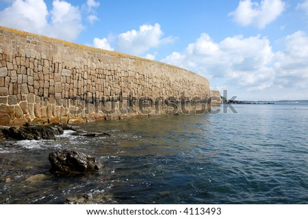The harbour sea wall, Mousehole, Cornwall, UK.