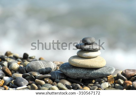 the harmony pyramid of stones on a gravel beach sea