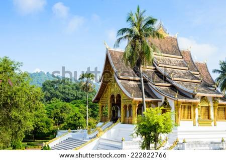 The Haw Pha Bang Buddha temple of the National museum complex of Luang Prabang, Laos. - stock photo