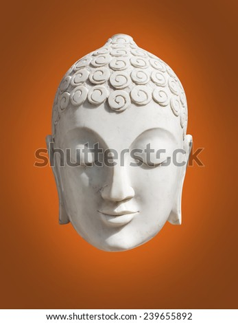 The head of a Buddha statue. - stock photo