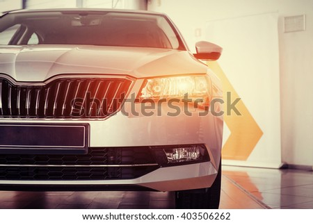 The headlights and the hood of a black sports car. - stock photo