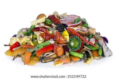 The heap of the edible decaying organic  from a garbage can lies on a white table - stock photo