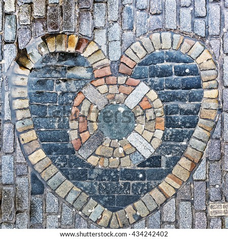 The Heart of Midlothian, built into the cobblestones of Edinburgh's Royal Mile in the nineteenth century. It is considered good luck to spit on the heart as you pass. - stock photo