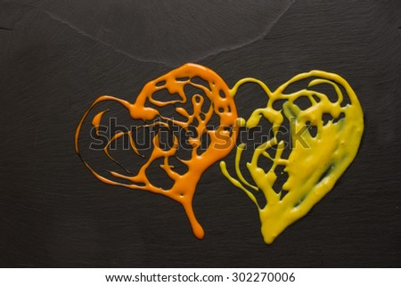 the heart of the orange sauce on the black stone - stock photo