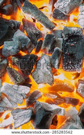 The heat of the burning wood and charcoal - stock photo
