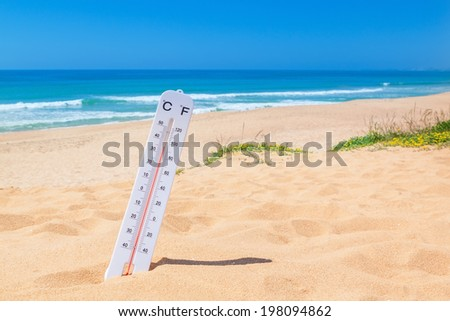 The heat on the beach. Thermometer for temperature weather. - stock photo