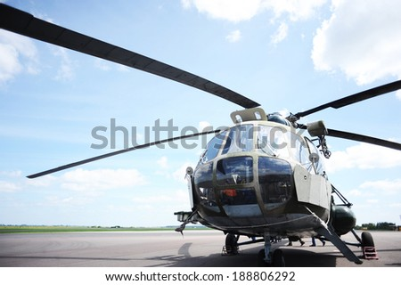 the helicopter in airfield waits for command for take-off - stock photo