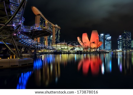 The Helix bridge, Marina Bay Sands and ArtScience museum with downtown in background, Singapore - stock photo
