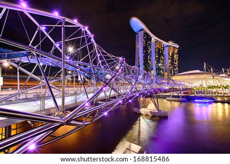 The Helix bridge with Marina Bay Sands in background, Singapore - stock photo